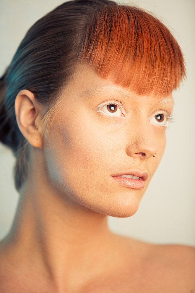 etherial minimalist beauty photographer, orange hair, white brows