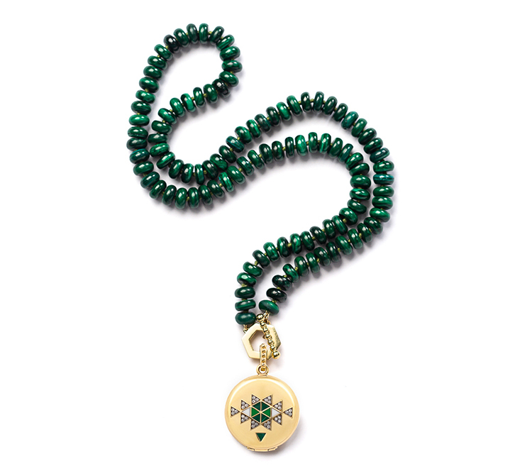 Pendant necklace with green beads. Catalog product photography for jewelry design.