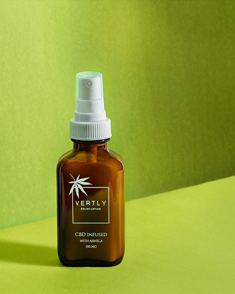Simple styled product photography with graphic color backgrounds. Green background with CBD beauty product bottle. Photographed by bay area photographer Ella Sophie