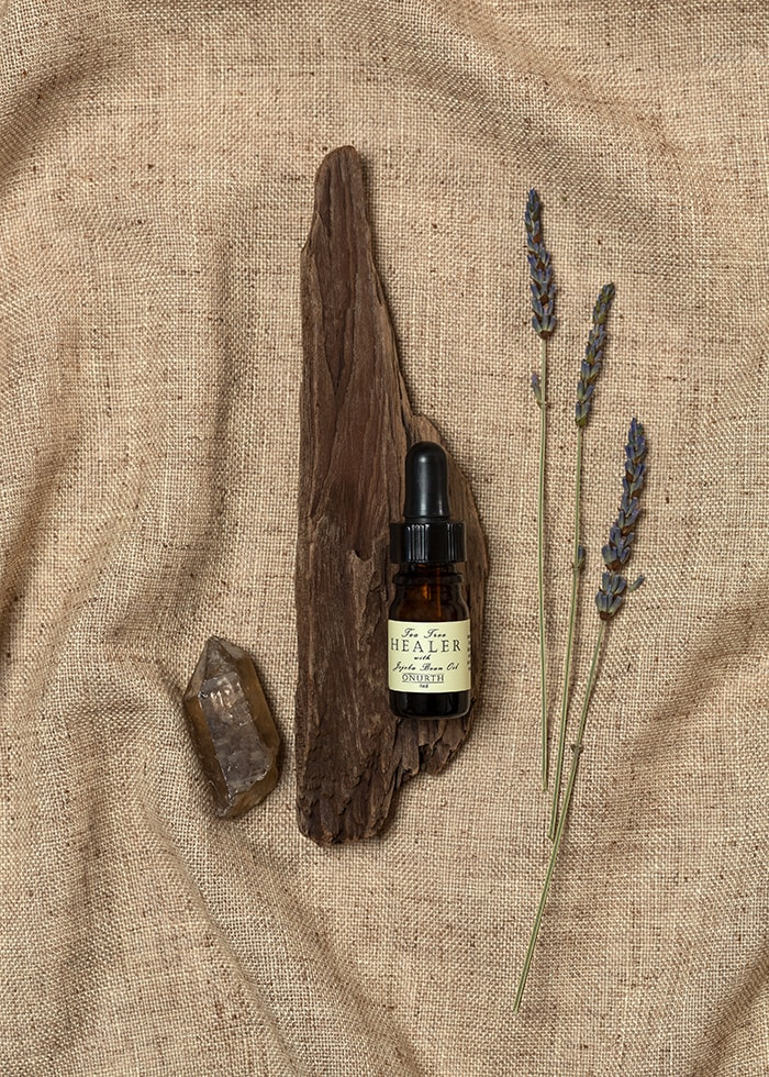 Facial oil styled product photo. Natural beauty products styled with burlap wood and natural elements. By bay area photographer Ella Sophie