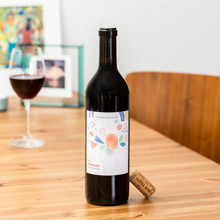 Styled, lifestyle wine bottle photo. Redwine bottle with cork on table. Photographed by Ella Sophie, bay area product photographer