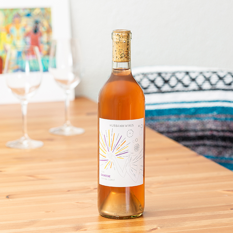 Women owned winery with artistic labels. Creative wine bottle product photography by Oakland photographer Ella Sophie. Rose Wine bottle on table